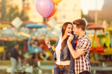 Photo for  Young romantic man in love feeding his girlfriend with cotton candy - Royalty Free Image