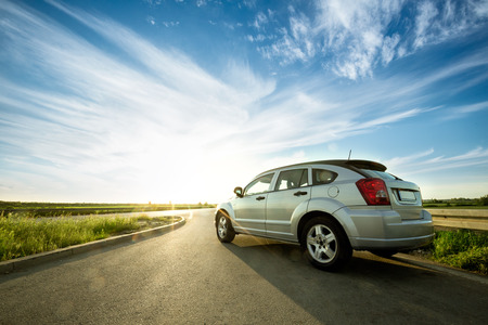 Photo for  modern car on road wih with sun reflections - Royalty Free Image