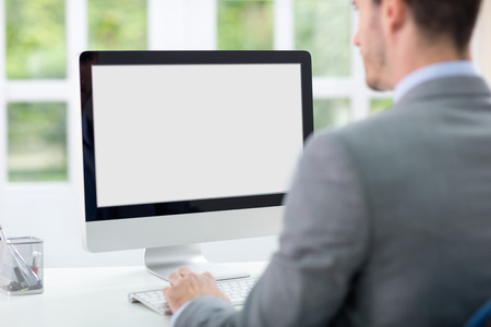 Foto de Businessman looking at computer screen - Imagen libre de derechos