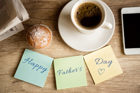 Photo for work desk with happy father's day on sticky paper - Royalty Free Image