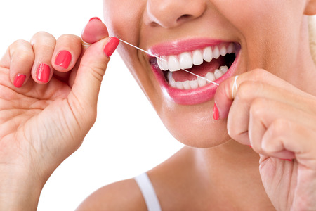 Foto de Dental flush - woman flossing teeth smiling - Imagen libre de derechos