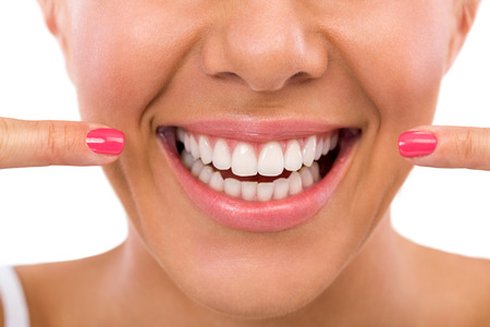 Photo pour Smiling woman showing her perfect white teeth - image libre de droit