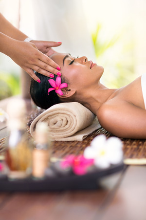 Photo for young woman receiving head massage in spa environment - Royalty Free Image