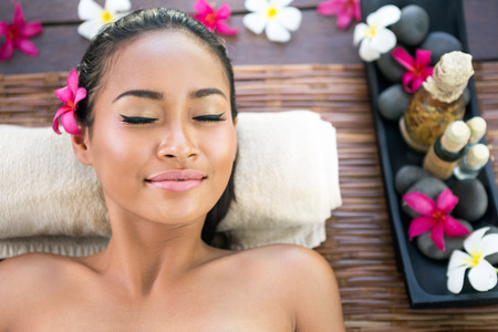 Photo pour Serene woman with closed eyes enjoying in spa treatment - image libre de droit