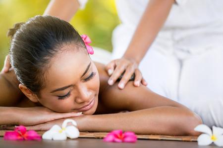 Photo pour Woman having Balinese massage in the spa salon, outdoor - image libre de droit