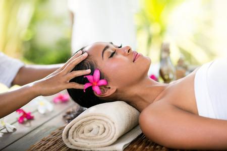 Photo pour Young woman receiving recreation Balinese massage in spa - image libre de droit