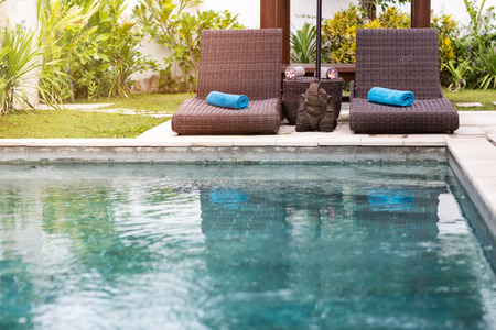 Photo for Clear blue water in swimming pool and sunbeds, tropical resort - Royalty Free Image