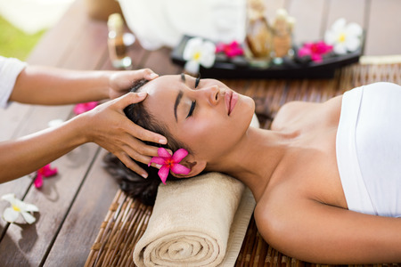 Photo for Masseur doing massage the head of an Asian woman in the spa salon - Royalty Free Image