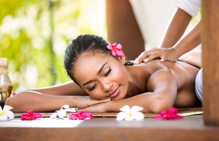 Photo pour Woman having relaxing Asian massage in spa salon - image libre de droit