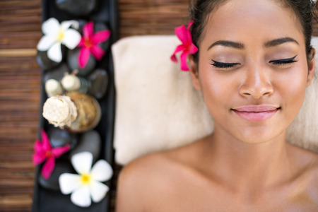 Foto de Serene beautiful spa woman relaxing on massage desk - Imagen libre de derechos