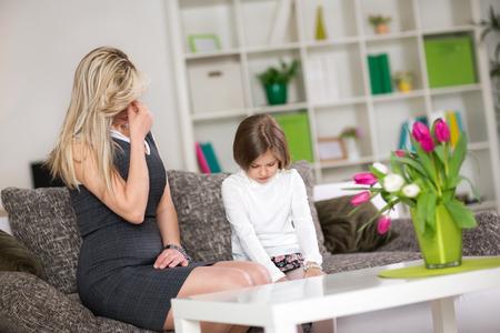 Foto de upset mom with  naughty child, Mother having disagreement with daughter - Imagen libre de derechos