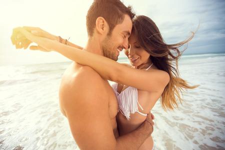 Photo pour young happy couple with draw heart on tropical beach. Honeymoon - image libre de droit