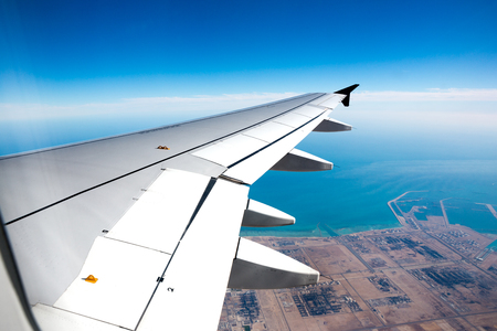 Photo pour View from a jet plane window of airplane wing during landing - image libre de droit