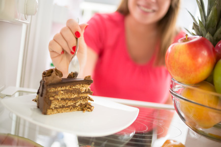 Photo pour Lovely piece of chocolate cake attracts girl to take it - image libre de droit