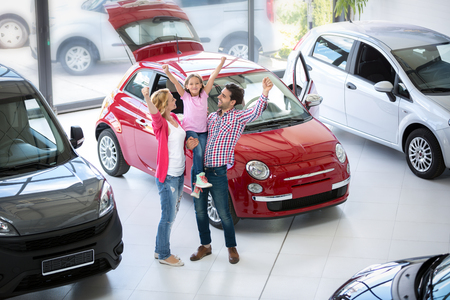 Photo pour excited family buying a new car in the car dealership  saloon - image libre de droit