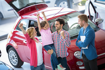 Photo pour Happy and excited family celebrating just bought a new car from dealership - image libre de droit