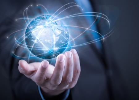 Photo pour Businessman holding planet Earth in palm.  - image libre de droit