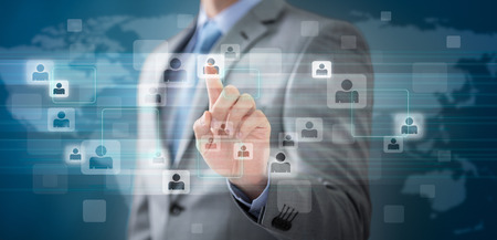 Photo pour Businessman choosing the right person pointing with finger in people icon.  - image libre de droit
