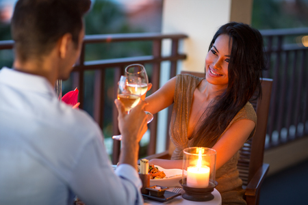 Foto de Couple having intimate dinner for two on the terrace of summer evening - Imagen libre de derechos