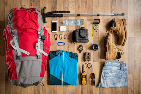 Foto de top view travel things on the floor for mountain trip - Imagen libre de derechos