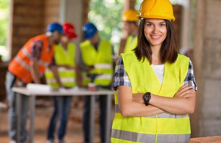 Foto de Portrait of young student of architecture on construction site - Imagen libre de derechos