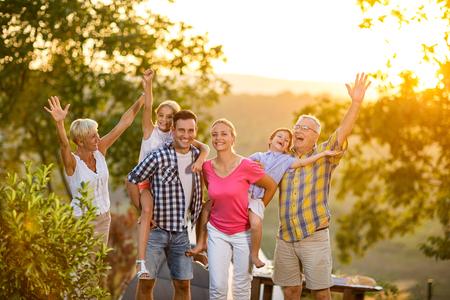 Foto de happy family on vacation posing together concept - Imagen libre de derechos