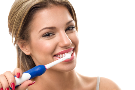 Photo pour Young beautiful woman brushing her healthy teeth, oral hygiene - image libre de droit