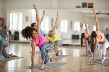 Photo pour Yoga training in course indoor - image libre de droit
