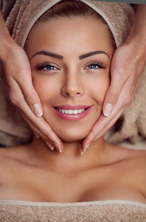 Photo pour Spa woman, close-up of a young woman getting spa treatment, face massage - image libre de droit