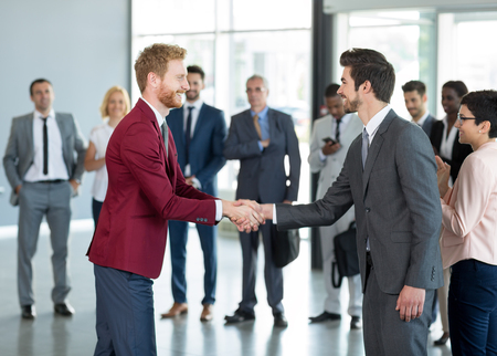 Photo for business partners handshaking in the sign of successful dealing - Royalty Free Image