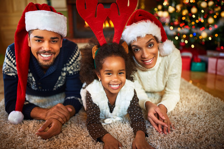 Photo pour Happy smiling African American family in Christmas atmosphere - image libre de droit