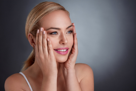 Photo pour middle age woman tightening skin on face with hand, make you look younger - image libre de droit