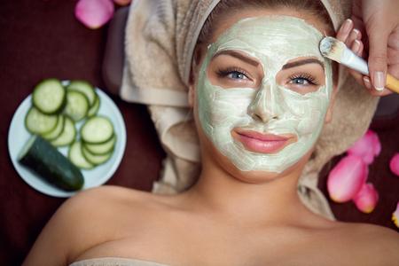 Foto de Healthy skin requires care, natural mask on face of beautiful woman - Imagen libre de derechos