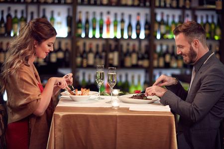 Photo pour Dinner for two, couple in famous restaurant - image libre de droit