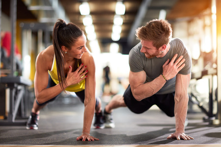 Foto für Man and woman strengthen hands at fitness training - Lizenzfreies Bild