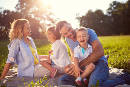 Foto de Young family with children having fun in nature - Imagen libre de derechos