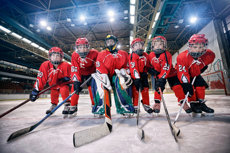 Photo for Youth hockey team - children play ice hockey - Royalty Free Image