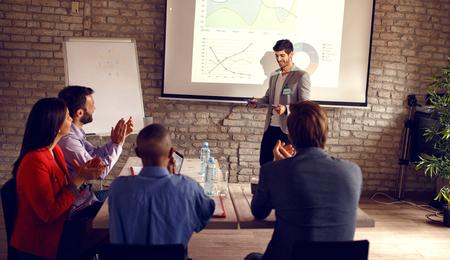 Photo pour Male holding business presentation about success in business - image libre de droit