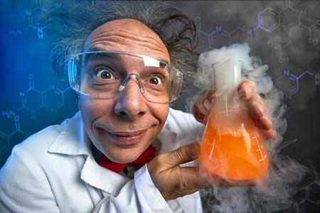 Foto de Crazy chemist with test tube, funny scientist - Imagen libre de derechos