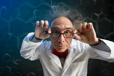 Foto de crazy scientist looking thought  glasses in camera - Imagen libre de derechos
