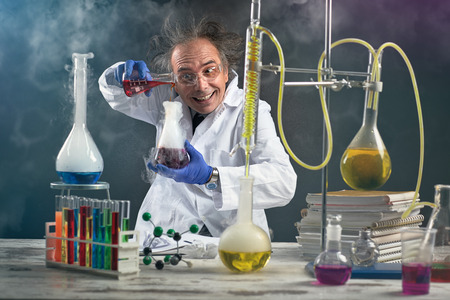 Foto de Crazy chemist doing experiment chemical laboratory - Imagen libre de derechos