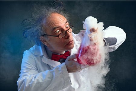 Foto de  chemist crazy about his experiment smell his experiment - Imagen libre de derechos