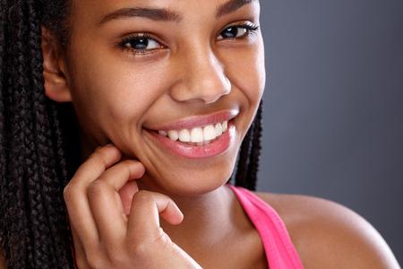 Foto de Face of Afro-American girl with nice smile with beautiful teeth  - Imagen libre de derechos