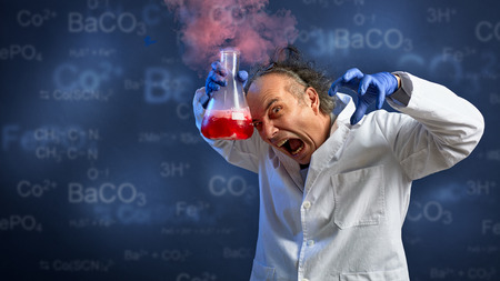 Foto de Mad chemist yelling and holding very with toxic chemicals in tube - Imagen libre de derechos