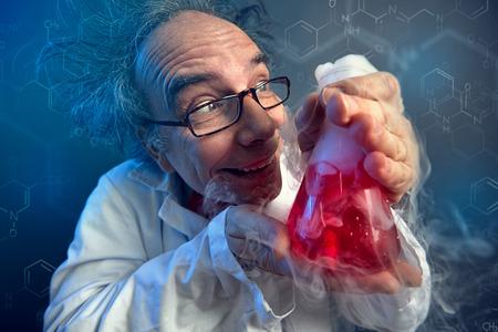 Foto de funny scientist, crazy chemist lovingly looking at test tube - Imagen libre de derechos