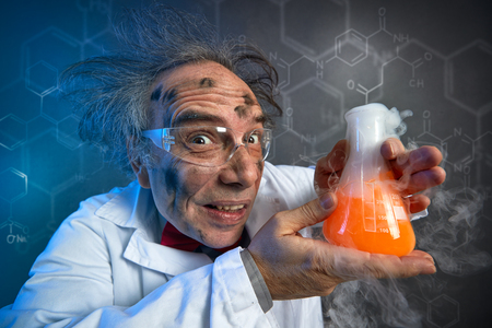 Foto de scientist with the dirty face of the explosion holding tube with chemicals - Imagen libre de derechos