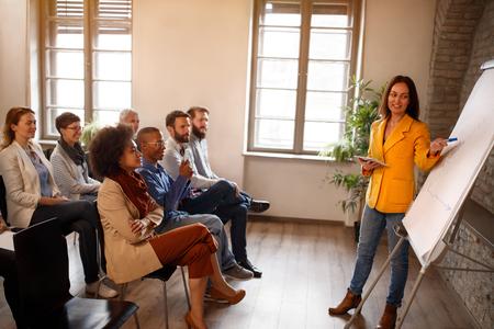 Photo pour Multiethnic employees on business meeting indoor - image libre de droit