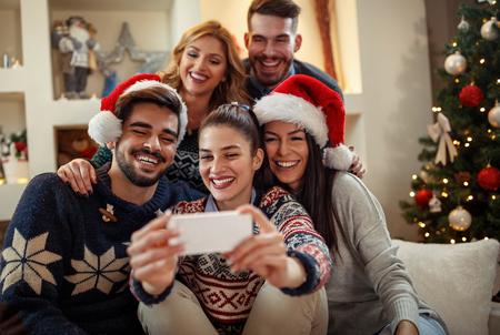 Foto de Young happy people making Christmas selfie - Imagen libre de derechos