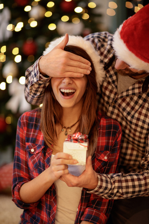 Foto für Young girlfriend has Christmas surprise from boyfriend - Lizenzfreies Bild