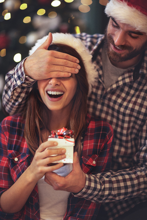 Foto für Excited girl has Christmas surprise from boyfriend - Lizenzfreies Bild